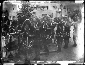 A_line_of_dancing_braves_in_the_Hopi_Snake_Dance_Ceremony_at_its_height,_Oraibi,_Arizona,_ca.1898_(CHS-3355)