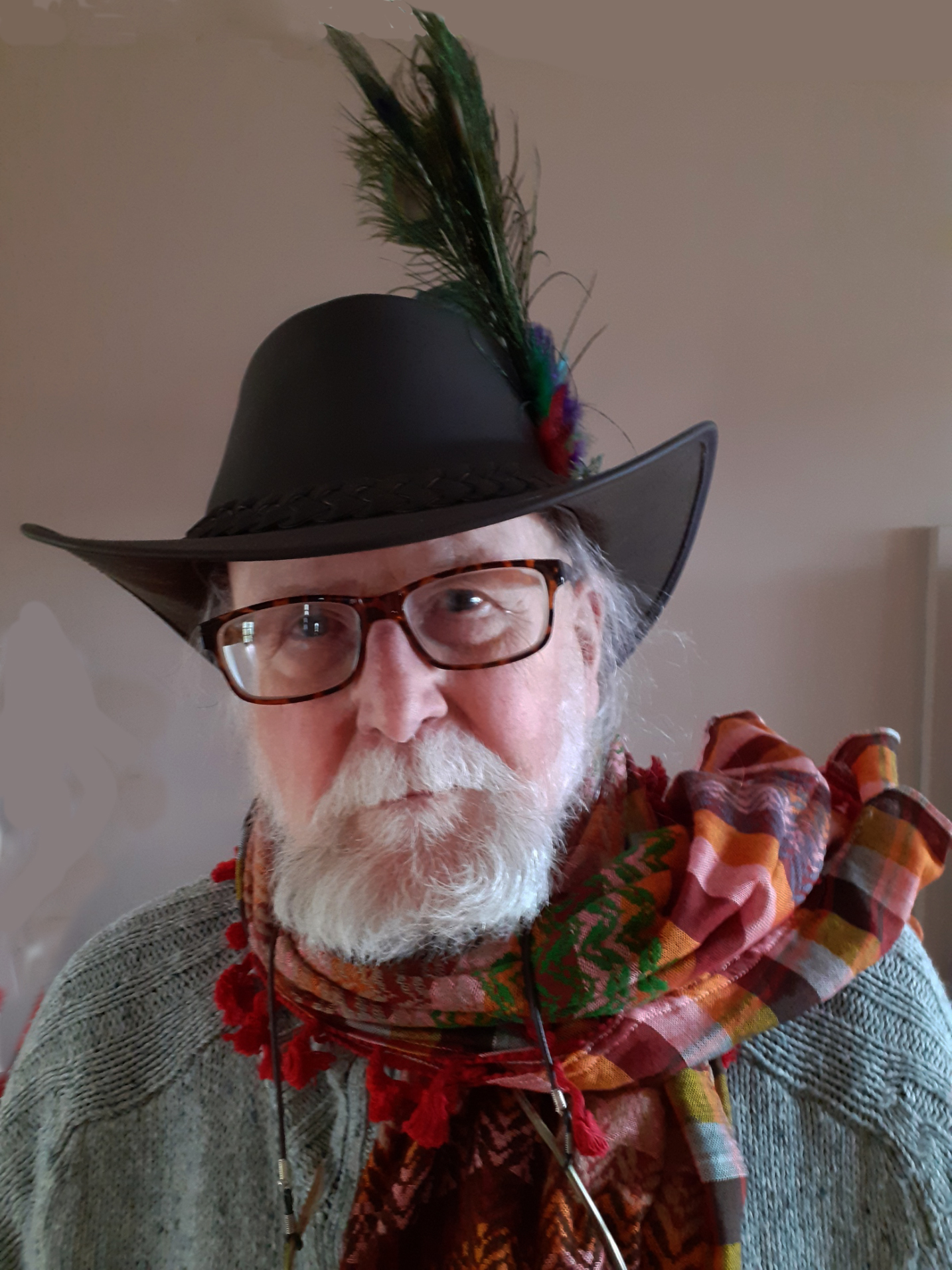 photo of Jeff Merrifield, an older man with a beard, wearing a hat with a feather in